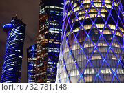 Купить «Doha, Qatar - Nov 18. 2019. Tornado Tower and other skyscrapers at night», фото № 32781148, снято 18 ноября 2019 г. (c) Володина Ольга / Фотобанк Лори