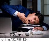 Купить «The businessman working overtime long hours late in office», фото № 32788124, снято 9 октября 2017 г. (c) Elnur / Фотобанк Лори
