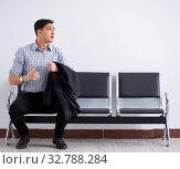 Купить «Man nervously impatiently waiting in the lobby», фото № 32788284, снято 18 января 2018 г. (c) Elnur / Фотобанк Лори
