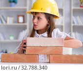 Купить «Young girl building with construction bricks», фото № 32788340, снято 21 июня 2017 г. (c) Elnur / Фотобанк Лори