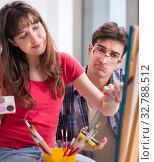 Купить «Artist coaching student in painting class in studio», фото № 32788512, снято 10 ноября 2017 г. (c) Elnur / Фотобанк Лори