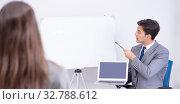 Купить «The business presentation in the office with man and woman», фото № 32788612, снято 7 августа 2017 г. (c) Elnur / Фотобанк Лори