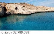 Купить «View from the sea to Caves in Cavo Greco in Protaras, Cyprus», видеоролик № 32789388, снято 21 октября 2019 г. (c) Володина Ольга / Фотобанк Лори