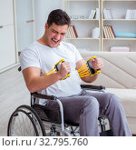 Купить «Disabled man recovering from injury at home», фото № 32795760, снято 2 мая 2017 г. (c) Elnur / Фотобанк Лори