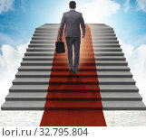 Купить «The young businessman climbing stairs and red carpet into sky», фото № 32795804, снято 29 февраля 2020 г. (c) Elnur / Фотобанк Лори