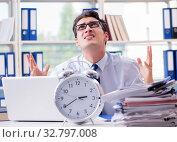 Купить «Businessman missing deadline for deliverables in office», фото № 32797008, снято 21 сентября 2017 г. (c) Elnur / Фотобанк Лори