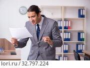 Unhappy male businessman in the office. Стоковое фото, фотограф Elnur / Фотобанк Лори