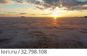 Купить «Flying over frozen sea at amazing sunset with red Sun and clouds», видеоролик № 32798108, снято 18 декабря 2019 г. (c) Serg Zastavkin / Фотобанк Лори