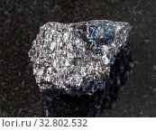 Купить «Macro shooting of natural mineral rock specimen - rough Black coal stone on dark granite background from Donets Black Coal Basin (Donbass)», фото № 32802532, снято 6 июля 2020 г. (c) easy Fotostock / Фотобанк Лори