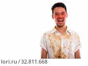 Купить «Studio shot of young Asian man from Thailand», фото № 32811668, снято 26 мая 2020 г. (c) easy Fotostock / Фотобанк Лори