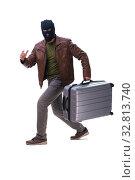 Купить «Robber wearing balaclava isolated on white background», фото № 32813740, снято 17 мая 2019 г. (c) Elnur / Фотобанк Лори