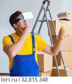 Купить «The painter contractor working with virtual reality goggles», фото № 32815348, снято 23 мая 2017 г. (c) Elnur / Фотобанк Лори