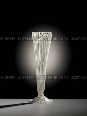 Filigree glass flute glass, Low arched foot with folded rim. Trunk formed by a hollow nodus. Funnel shaped chalice. Base, trunk and chalice with vertical...