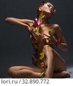 Купить «Sexy girl poses with butterflies on her naked body», фото № 32890772, снято 19 августа 2016 г. (c) Гурьянов Андрей / Фотобанк Лори