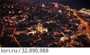 Купить «Night aerial view of downtown of Lisbon overlooking medieval Cathedral and Castle of Sao Jorge, Portugal», видеоролик № 32890988, снято 22 мая 2019 г. (c) Яков Филимонов / Фотобанк Лори