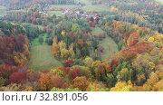 Купить «Picturesque view of country landscape with colorful trees on hillsides in autumn day», видеоролик № 32891056, снято 18 октября 2019 г. (c) Яков Филимонов / Фотобанк Лори