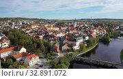 Купить «Autumn landscape with Old Town of Czech city of Pisek on banks of Otava river on sunny day», видеоролик № 32891072, снято 11 октября 2019 г. (c) Яков Филимонов / Фотобанк Лори