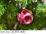 Купить «Шарик времён СССР на ветвях искусственной ели», эксклюзивное фото № 32891408, снято 29 декабря 2019 г. (c) Dmitry29 / Фотобанк Лори