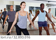 Купить «Cheerful people practicing vigorous lindy hop movements in dance class», фото № 32893016, снято 30 июля 2018 г. (c) Яков Филимонов / Фотобанк Лори