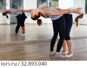 Купить «Women and men exercising in pairs during yoga class in modern fitness center», фото № 32893040, снято 30 июля 2018 г. (c) Яков Филимонов / Фотобанк Лори