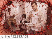 Young man in quest room with bloody traces. Стоковое фото, фотограф Яков Филимонов / Фотобанк Лори