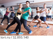Купить «Energy adults dancing salsa together in dance studio», фото № 32893140, снято 17 февраля 2020 г. (c) Яков Филимонов / Фотобанк Лори