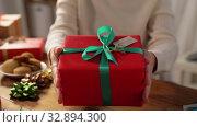 Купить «woman packing christmas gifts at home», видеоролик № 32894300, снято 18 декабря 2019 г. (c) Syda Productions / Фотобанк Лори