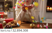 Купить «woman with confetti and christmas gifts at home», видеоролик № 32894308, снято 18 декабря 2019 г. (c) Syda Productions / Фотобанк Лори