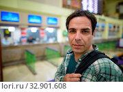 Купить «Portrait of handsome Persian tourist man at the railway station in Bangkok, Thailand», фото № 32901608, снято 7 июля 2020 г. (c) easy Fotostock / Фотобанк Лори