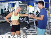 Купить «Couple during weightlifting workout», фото № 32903636, снято 16 июля 2018 г. (c) Яков Филимонов / Фотобанк Лори
