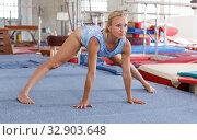 Купить «Woman doing acrobatics exercises», фото № 32903648, снято 18 июля 2018 г. (c) Яков Филимонов / Фотобанк Лори