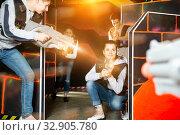 Young woman having fun on lasertag arena. Стоковое фото, фотограф Яков Филимонов / Фотобанк Лори