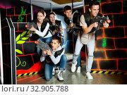 Купить «Five emotional young people play laser tag», фото № 32905788, снято 3 июня 2020 г. (c) Яков Филимонов / Фотобанк Лори