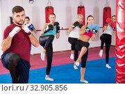 Купить «Group females and trainer are doing kick», фото № 32905856, снято 8 октября 2017 г. (c) Яков Филимонов / Фотобанк Лори