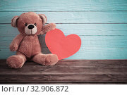 Купить «Teddy bear with red heart on old wooden background. Valentine's day concept», фото № 32906872, снято 14 декабря 2019 г. (c) Майя Крученкова / Фотобанк Лори