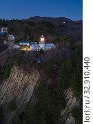 Купить «Краснодарский край, Туапсе, маяк на мысе Кадош поздним вечером», фото № 32910440, снято 2 января 2020 г. (c) glokaya_kuzdra / Фотобанк Лори
