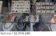 Купить «Colorful necklaces made from different precious stones for sale in jewelry store», видеоролик № 32914240, снято 31 октября 2019 г. (c) Яков Филимонов / Фотобанк Лори