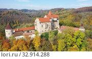 Купить «Scenic aerial view of historical medieval Pernstejn castle, Czech Republic», видеоролик № 32914288, снято 15 октября 2019 г. (c) Яков Филимонов / Фотобанк Лори