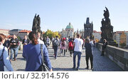 Купить «ancient stone Charles Bridge across Vltava river decorated with baroque sculptures on sunny autumn day, Prague, Czech Republic», видеоролик № 32914576, снято 13 октября 2019 г. (c) Яков Филимонов / Фотобанк Лори