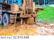 Russia, Samara, September 2019: a special machine drills a well for water on a village street. Стоковое фото, фотограф Акиньшин Владимир / Фотобанк Лори