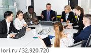 Купить «business partners discussing projects and ideas at meeting», фото № 32920720, снято 10 марта 2018 г. (c) Яков Филимонов / Фотобанк Лори