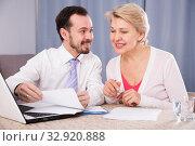 Купить «Woman and manager discuss contract», фото № 32920888, снято 31 марта 2020 г. (c) Яков Филимонов / Фотобанк Лори
