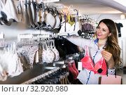 Купить «Happy woman client choosing pretty lingerie», фото № 32920980, снято 20 марта 2017 г. (c) Яков Филимонов / Фотобанк Лори