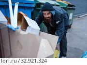Купить «Bearded homeless searching food in trashcan», фото № 32921324, снято 26 октября 2019 г. (c) Tryapitsyn Sergiy / Фотобанк Лори