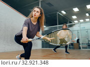 Two players with squash racket playing on court. Стоковое фото, фотограф Tryapitsyn Sergiy / Фотобанк Лори