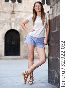 Romantic girl leaning against stone wall. Стоковое фото, фотограф Яков Филимонов / Фотобанк Лори