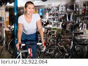 Portrait of woman who is standing with new bicycle indoors. Стоковое фото, фотограф Яков Филимонов / Фотобанк Лори