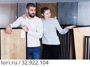 Купить «couple looking laminated flooring», фото № 32922104, снято 2 февраля 2018 г. (c) Яков Филимонов / Фотобанк Лори