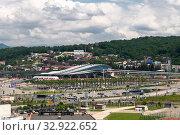 Купить «Sochi, Russia - June 5. 2018. Cityscape with railway station Olympic Park in Adler», фото № 32922652, снято 5 июня 2018 г. (c) Володина Ольга / Фотобанк Лори
