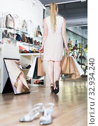 Купить «Client woman with bags of purchases is walking», фото № 32934240, снято 27 мая 2017 г. (c) Яков Филимонов / Фотобанк Лори